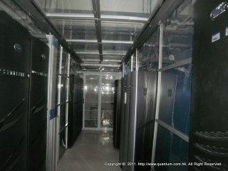 Another view inside cold aisle facing sliding door entrance featuring side air-block panels